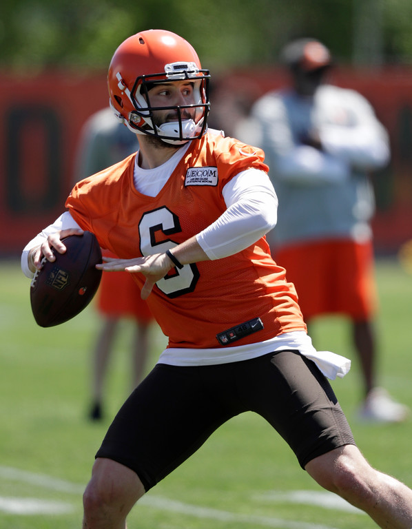 . Cleveland Browns quarterback Baker Mayfield looks to pass during a practice at the NFL football team\'s training camp facility, Wednesday, May 23, 2018, in Berea, Ohio. (AP Photo/Tony Dejak)