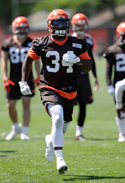 . Cleveland Browns running back Carlos Hyde runs a drill during a practice at the NFL football team\'s training camp facility, Wednesday, May 23, 2018, in Berea, Ohio. (AP Photo/Tony Dejak)