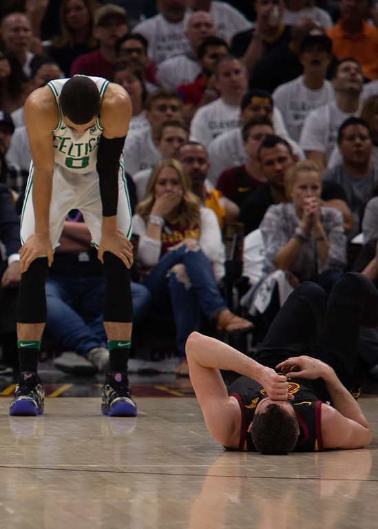 . Kevin Love of the Cleveland Cavaliers lies on the ground after suffering a concussion during game 6 of the Eastern Conference Finals at the Q on May 25, 2018. -Michael Johnson/ The News Herald