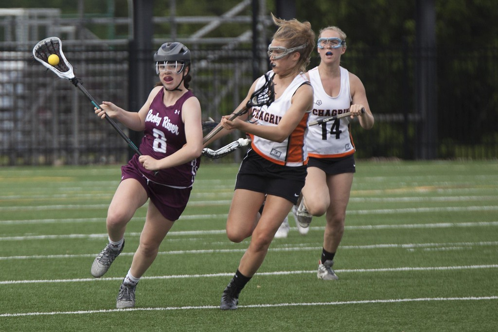 . With possession of the ball, River\'s Lauren Cain heads for the goal, but Tiger Kelly Wynveen stays close.  Jen Forbus - The Morning Journal