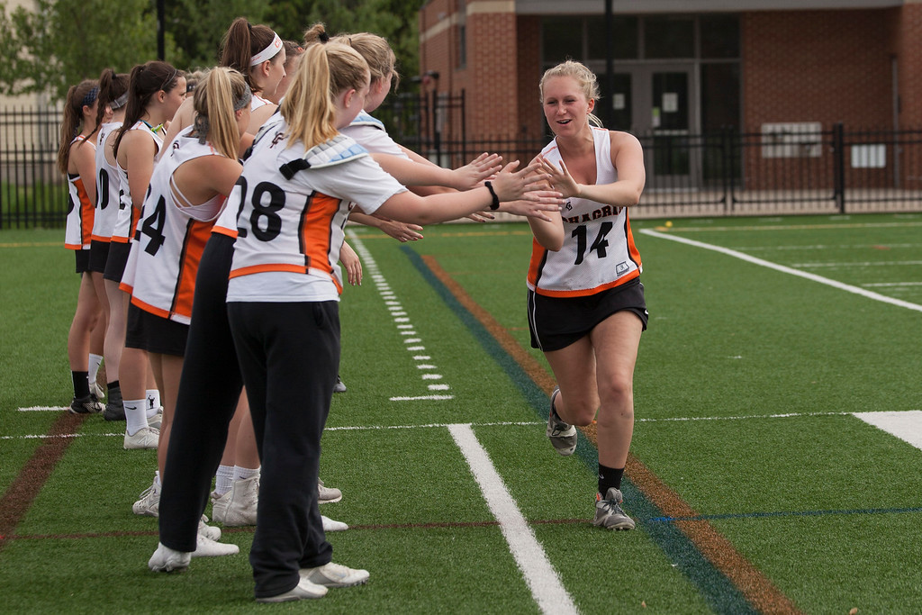 . Tiger Reagan Dowling slaps hands down the line as she\'s introduced at the beginning of Chagrin Falls\' semifinal game against the Rocky River PIrates. Jen Forbus - The Morning Journal