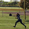 Lorain outfielder Kristal Grafal can't make a running catch on a deep fly ball. Randy Meyers -- The Morning Journal