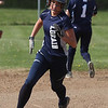 Lorain's Raegan Osko rounds second base and heads for third against Magnificat. Randy Meyers -- The Morning Journal