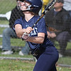 Magnificat's Sara Fessler delivers a hit against Lorain. Randy Meyers -- The Morning Journal