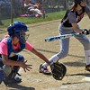 Paul DiCicco - The News-Herald<br />  Stazz catcher, Mia Welms of Wickliffe, receives the ball a little low and outside.  The Starzz and Explosive played to a 7-7 tie at the Willoughby Starzz Invitational on June 10.