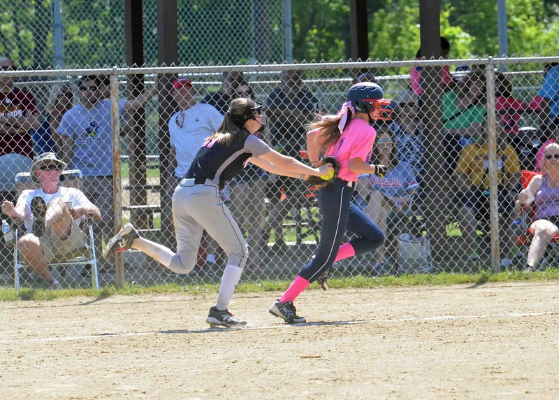 Paul DiCicco - The News-Herald<br /> A Starzz runner, caught in a run-down between home and third is tagged out by the pitcher.  the Starzz and Explosive played to a 7-7 tie.