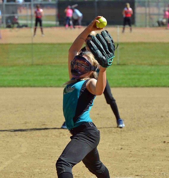 Paul DiCicco - The News-Herald<br /> Lady Landsharks (10u) pitcher, Alyssa Hall of Eastlake, winds up to deliver a pitch to the Bandits from Willowick.  The Lady Landsharks went on to win 8-0 at the Willoughby Starzz Invitational at Todd Field on June 10.