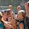 Paul DiCicco - The News-Herald<br />  The Lady Landsharks, coached by Brian Hall, breaking from a strategy huddle after playing the field.  The landsharks went on to beat the Bandits 8-0 at the Willoughby Starzz invitational on June 10.