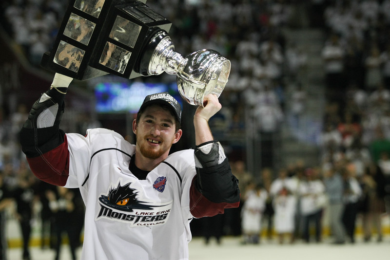 Michael Johnson - The News-Herald<br />   Lukas Sedlak of the Lake Erie Monsters hoists the Clader Cup after defeating the Hershey bears 4 games to none in The Calder Cup Finals. The Monsters defeated the Bears 1-0 in overtime at the Quicken Loans Arena on June 11, 2016.