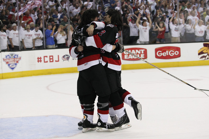 """Michael Johnson - The News-Herald<br />  The Lake Erie Monster """"Mullet Brothers"""" celebrate after the Monsters defeated the Hershey Bears 1-0 in overtime to win the Calder Cup at the Quicken Loans Arena on June 11, 2016."""