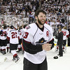 Michael Johnson - The News-Herald<br /> Lake Erie Monsters' Trent Vogelhuber smiles as his team celebrates winning the Calder Cup against the Hershey Bears 4 games to none.  The Monsters defeated the Bears 1-0 in overtime at the Quicken Loans Arena on June 11, 2016.