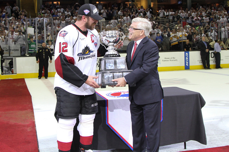 Michael Johnson - The News-Herald<br /> AHL President David Andrews presents Ryan Craig the Calder Cup after defeating the Hershey bears 4 games to none in The Calder Cup Finals. The Monsters defeated the Bears 1-0 in overtime at the Quicken Loans Arena on June 11, 2016.