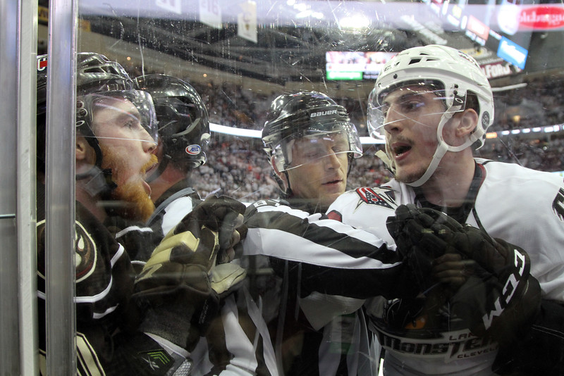 Michael Johnson - The News-Herald<br /> Zach Werenski of the Lake Erie Monsters (right) and Liam O'Brien of the Hershey Bears (left) are held back from each other during the 3rd period of game 4 of the Calder Cup Finals. The Lake Erie Monsters defeated the Hershey Bears 1-0 in overtime to win the Calder Cup.