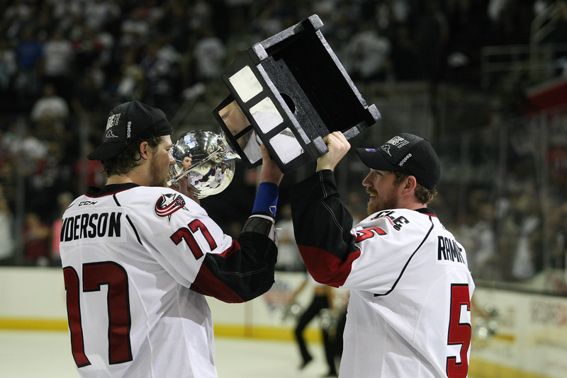 Michael Johnson - The News-Herald<br /> Lake Erie Monsters' Josh Anderson (left) and John Ramage (right) hoist the Calder Cup after defeating the Hershey bears 4 games to none in The Calder Cup Finals. The Monsters defeated the Bears 1-0 in overtime at the Quicken Loans Arena on June 11, 2016.