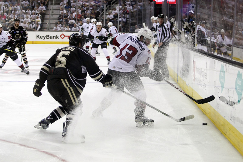 Michael Johnson - The News-Herald<br /> Lake Erie Monsters' Trent Vogelhuber (right) fights for the puck against Hershey Bears' Christian Djoos during game 4 of the Calder Cup Finals at the Quicken Loans Arena on June 11, 2016. The Lake Erie Monsters defeated the Hershey Bears 1-0 in overtime to win the Calder Cup.