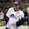 Michael Johnson - The News-Herald<br /> Ryan Craig of the Lake Erie Monsters is handed spray paint by AHL President David Andrews to cross off their final game to win the Calder Cup at the Quicken Loans Arena on June 11, 2016.