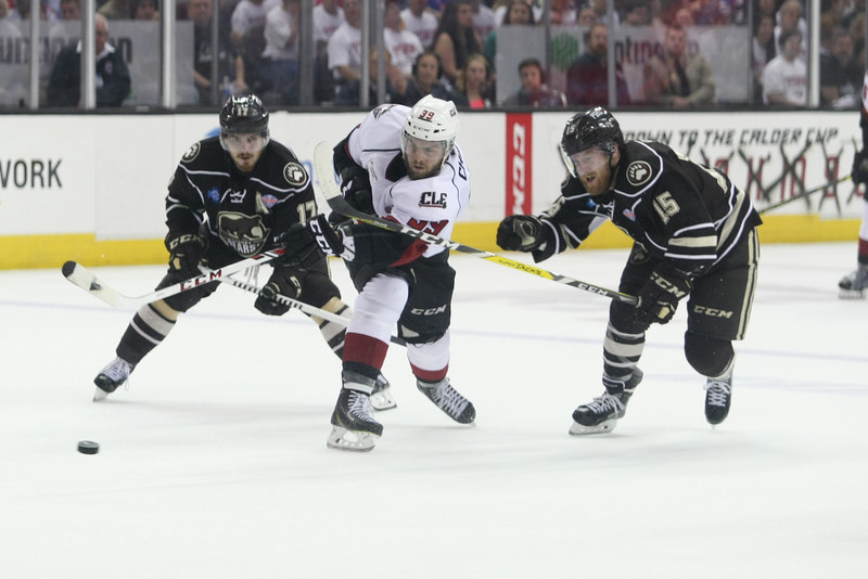 Michael Johnson - The News-Herald<br /> Lake Erie Monsters' Michael Chaput shoots the puck through Hershey Bears defenders during the second period of game 4 of the Calder Cup Finals at the Quicken Loans Arena on June 11, 2016. The Lake Erie Monsters defeated the Hershey Bears 1-0 in overtime to win the Calder Cup.