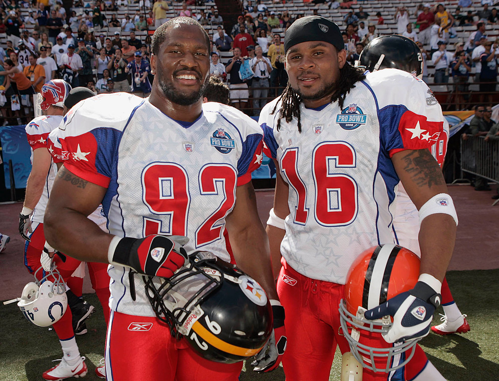 . AFC teammates James Harrison, left, of the Pittsburgh Steelers, and Josh Cribbs, of the Cleveland Browns, pose before the start of the Pro Bowl football game in Honolulu, Sunday, Feb. 10, 2008.  Both Harrison and Cribbs are former Kent State players.  (AP Photo/Marco Garcia)