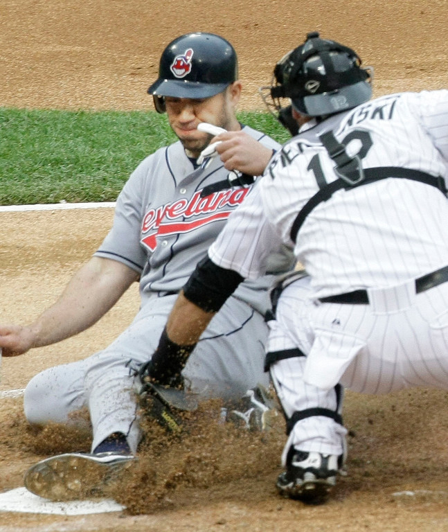. Chicago White Sox catcher A.J. Pierzynski tags out Cleveland Indians\' Travis Hafner after White Sox shortstop Alexei Ramirez threw home during the second inning of a baseball game Saturday, June 6, 2009 in Chicago. (AP Photo/Charles Rex Arbogast)