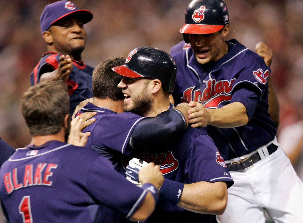 . Cleveland Indians\' Travis Hafner, center, is mobbed by his teammates after his 11th-inning single drove in the winning run in the Indians\' 2-1 win over the New York Yankees in Game 2 of an American League Division Series baseball game Friday, Oct. 5, 2007, in Cleveland. (AP Photo/Tony Dejak)