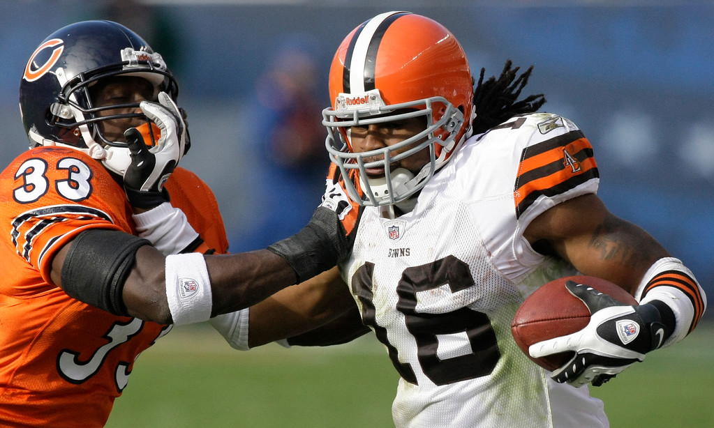. Cleveland Browns wide receiver Josh Cribbs (16) stiff-arms Chicago Bears cornerback Charles Tillman (33) in the second half of an NFL football game in Chicago, Sunday, Nov. 1, 2009. (AP Photo/Charles Rex Arbogast)