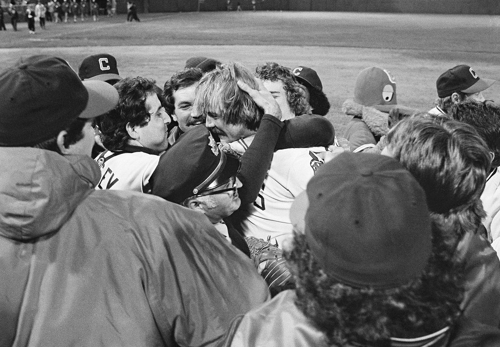 . Cleveland Indians pitcher Len Barker, center, is mobbed by teammates on the mound after he pitched a perfect game against the Toronto Blue Jays in Cleveland Stadium, May 16, 1981. The feat in which Barker also struck out 11 was the first since Catfish Hunter accomplished it 13 years ago. (AP Photo/Mark Duncan)