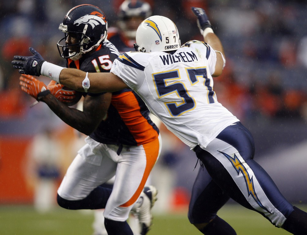 . San Diego Chargers linebacker Matt Wilhelm, right, reaches out to tackle Denver Broncos wide receiver Brandon Marshall in the fourth quarter of the Chargers\' 41-3 victory in an NFL football game in Denver on Sunday, Oct. 7, 2007.  (AP Photo/Jack Dempsey)