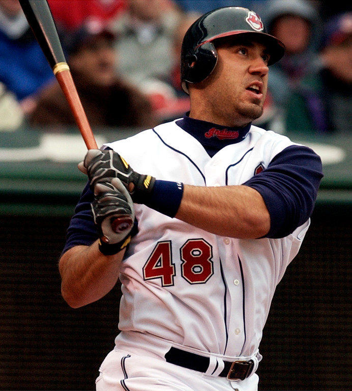. Cleveland Indians\' Travis Hafner watches his grand slam off Minnesota Twins pitcher Kyle Lohse in the third inning Monday, April 12, 2004 in Cleveland.  (AP Photo/Tony Dejak)
