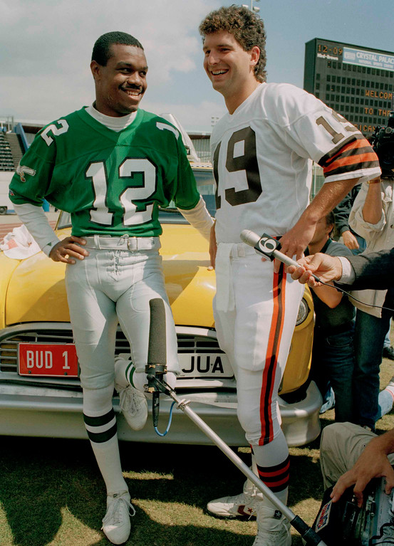 . Philadelphia Eagles quarterback Randall Cunningham, left, and Cleveland Browns\' quarterback Bernie Kosar shown together during a training session at Crystal Palace in London, Aug. 1, 1989. (AP Photo/Gill Allen)