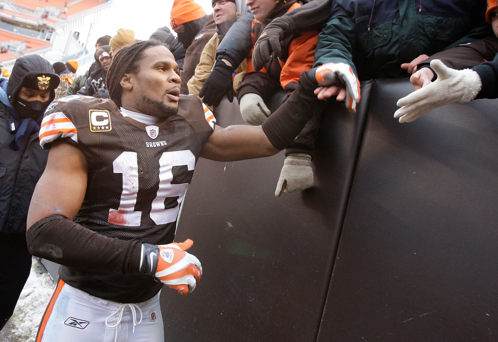 . Cleveland Browns wide receiver Josh Cribbs (16) greets fans after the team beat the Jacksonville Jaguars in their NFL football game Sunday, Jan. 3, 2010, in Cleveland. (AP Photo/Amy Sancetta)