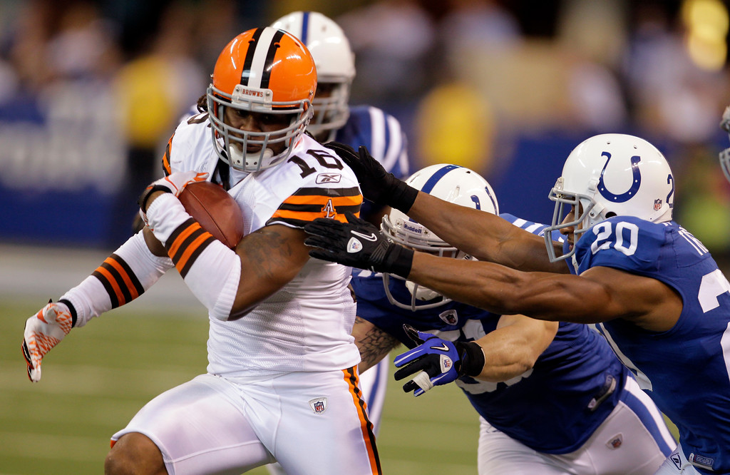 . Cleveland Browns wide receiver Josh Cribbs, left, tries to break the tackle of Indianapolis Colts outside linebacker Pat Angerer, center, and free safety Mike Adams in the second quarter of an NFL football game in Indianapolis, Sunday, Sept. 18, 2011. (AP Photo/Darron Cummings)