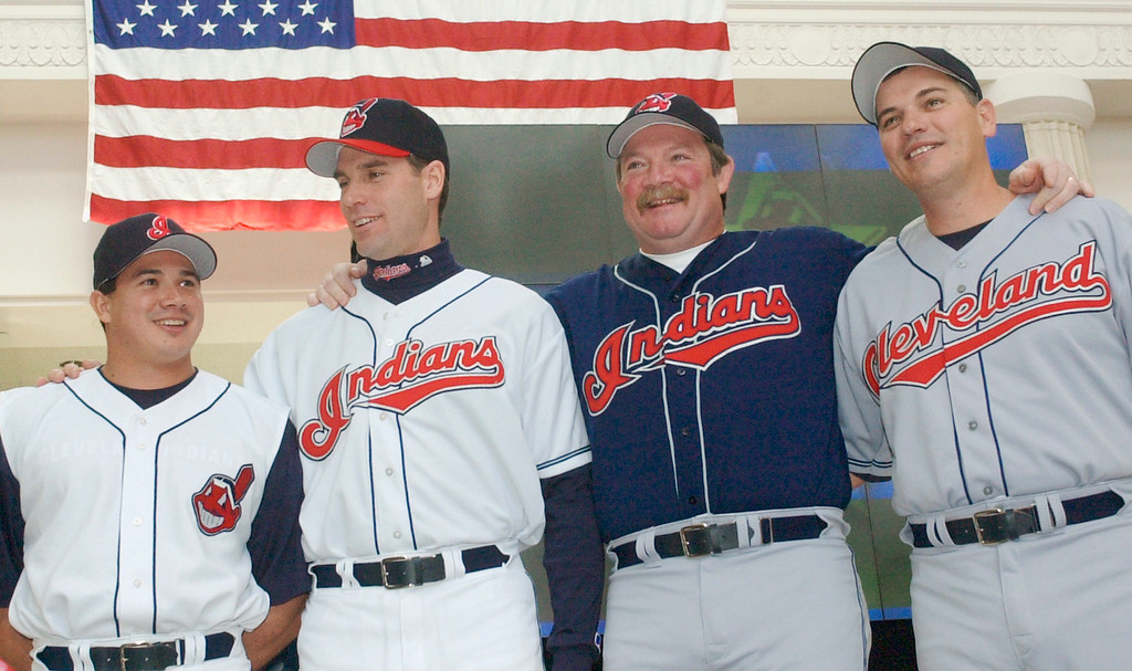 . The Cleveland Indians revealed their new uniforms during a fashion show in Cleveland, Friday, Feb. 8, 2002. From left: Catcher Einar Diaz wears the alternate home uniform with the Chief Wahoo logo; coach Joel Skinner is in the home whites; former pitcher Len Barker models the alternate road uniform; and former rookie of the year Joe Charboneau wears the road gray. The Indians had not changed uniforms since moving into Jacobs Field in 1994. (AP Photo/Mark Duncan)
