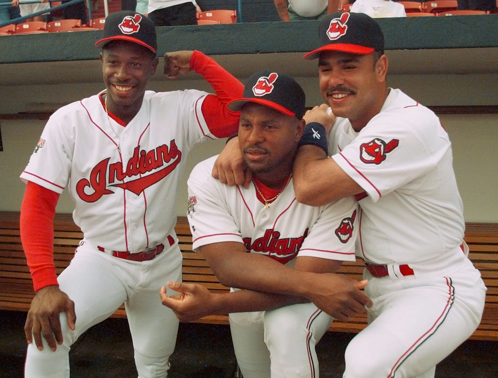 . Cleveland Indians outfielder Kenny Lofton, left, pumps his arm as second baseman Carlos Baerga, right, poses with teammate Albert Belle after picture day at the team\'s spring training camp in Winter Haven, Fla., Wednesday, Feb. 28, 1996.  Major League Baseball is expected to fine Belle as much as $50,000 after verbally attacking and physically threatening a television reporter and her crew during last season\'s World Series, according to Baseball officials.   (AP Photo/Charles Krupa)