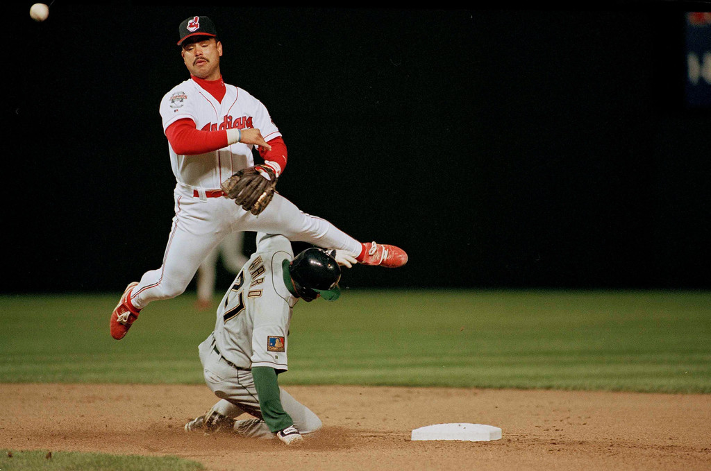 . Carlos Baerga tries for a double play over Turner Ward of the Milwaukee Brewers during game action in Cleveland, Ohio, May 17, 1994. (AP Photo/Mark Duncan)