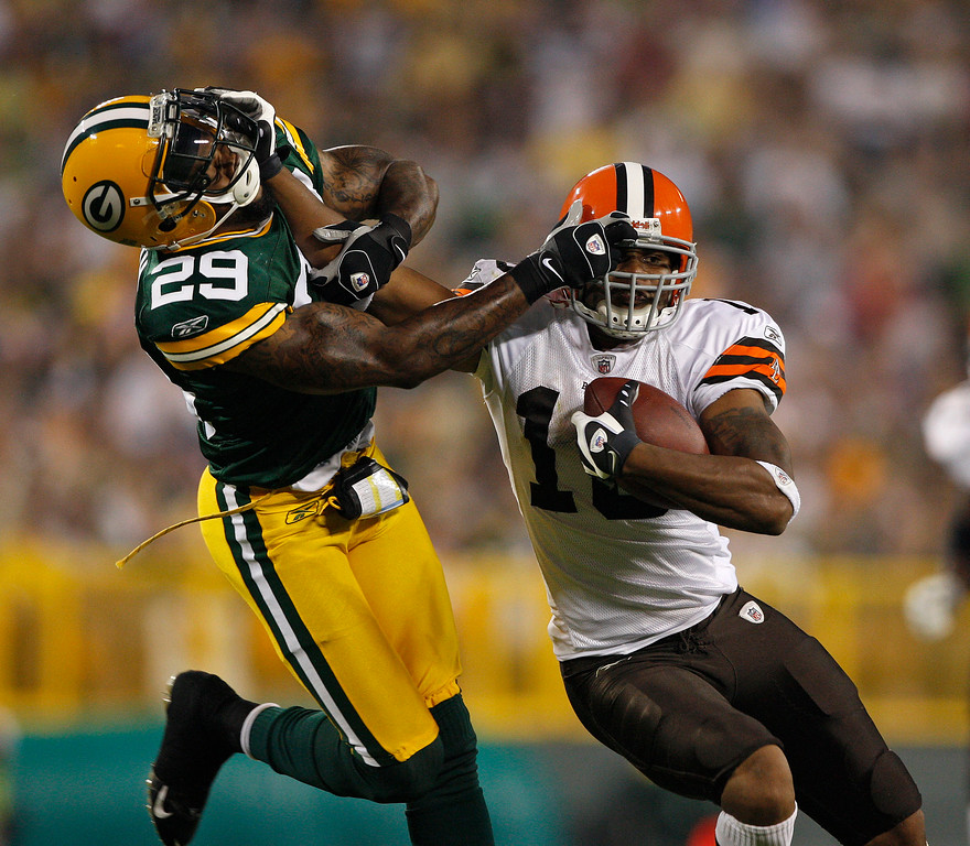 . Green Bay Packers\' Anthony Smith and Cleveland Browns\' Josh Cribbs during a NFL football game Saturday, June 15, 2009, in Green Bay. (AP Photo/Jim Prisching)