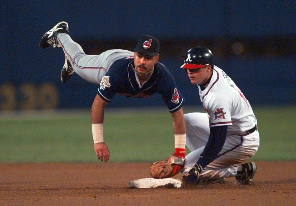 . Cleveland Indians second baseman Carlos Baerga gets upended as he gets the Atlanta Braves\' Ryan Klesko, right, out at second and turns the double play in the second inning of Game Six of the World Series Saturday, Oct. 28, 1995, in Atlanta.  (AP Photo/Eric Draper)