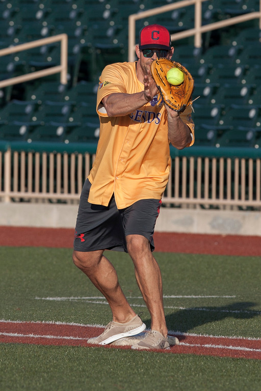. Jen Forbus - The Morning Journal<br> Cleveland Browns legend Joe Thomas makes the catch for an out at first during the Cleveland Legends softball game on June 23 at Sprenger Stadium.