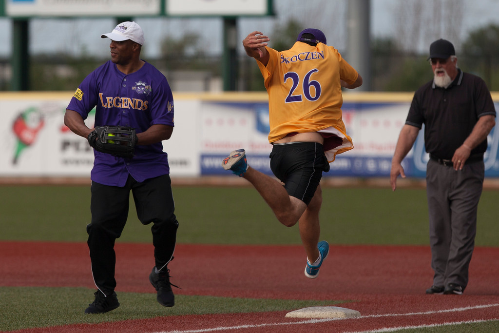 . Jen Forbus - The Morning Journal<br> Despite his leaping attempt, Dave Skoczen doesn\'t beat the throw to Je\'Rod Cherry at first base during the Cleveland Legends softball game on June 23 at Sprenger Stadium.