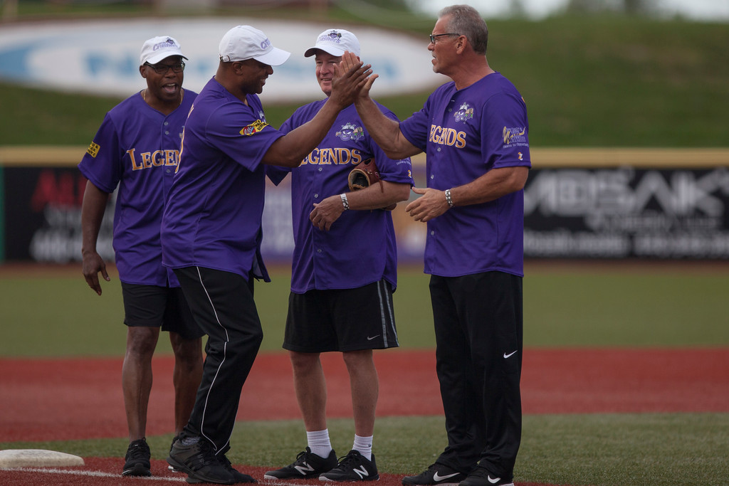 . Jen Forbus - The Morning Journal<br> ESPN radio host and former New England Patriot Je\'Rod Cherry greets fellow Purple teammates Kevin Mack, Mark Price and Joe Charboneau prior to the Cleveland Legends softball game on June 23 at Sprenger Stadium.
