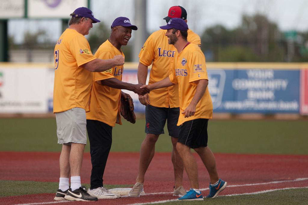 . Jen Forbus - The Morning Journal<br> ESPN host Dave Skoczen shakes hands with legends Joe Thomas, Austin Carr and Len Barker prior to the Cleveland Legends softball game on June 23 at Sprenger Stadium.