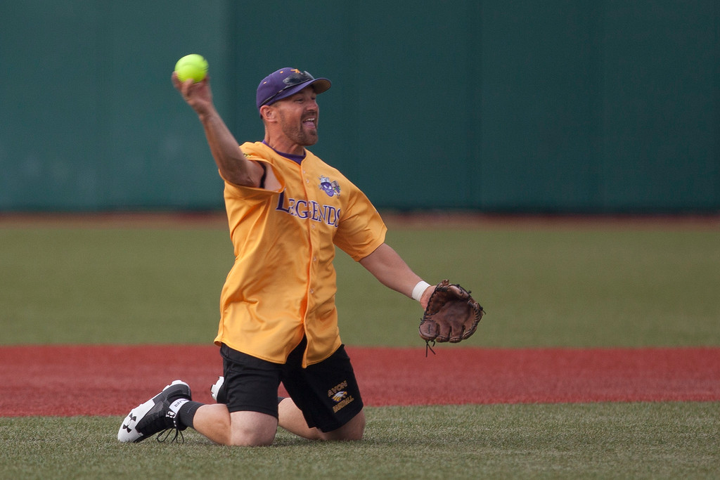 . Jen Forbus - The Morning Journal<br> Avon High School baseball coach Craig Kirschner makes a great catch at short stop for the Yellow team during the Cleveland Legends softball game on June 23 at Sprenger Stadium.