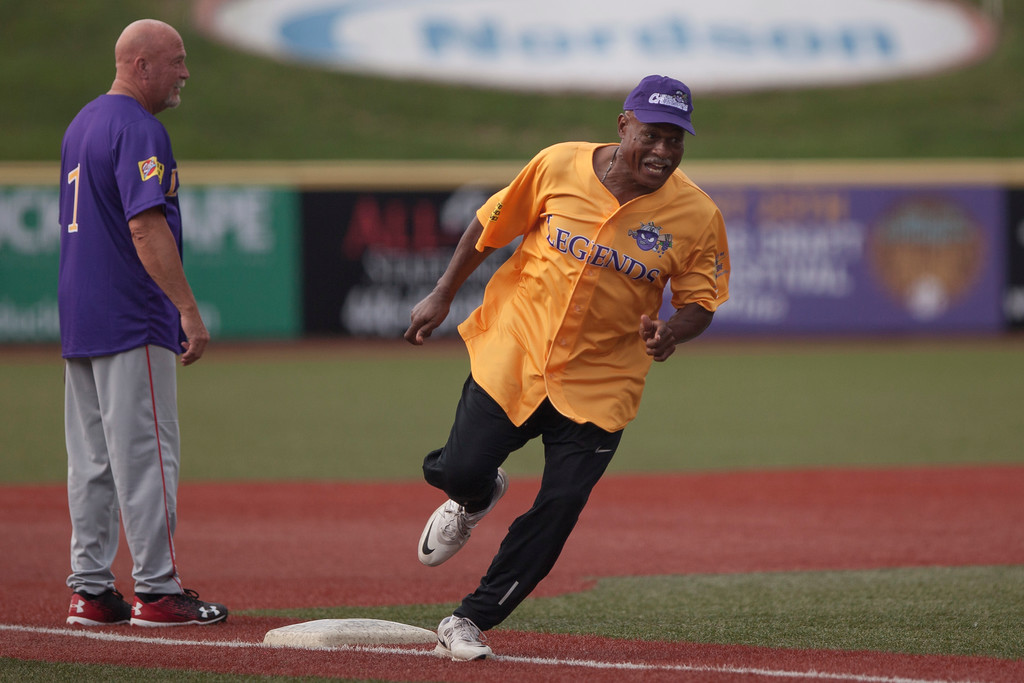 . Jen Forbus - The Morning Journal<br> Former Cleveland Cavalier Austin Carr rounds third and heads for home during the Cleveland Legends softball game on June 23 at Sprenger Stadium.