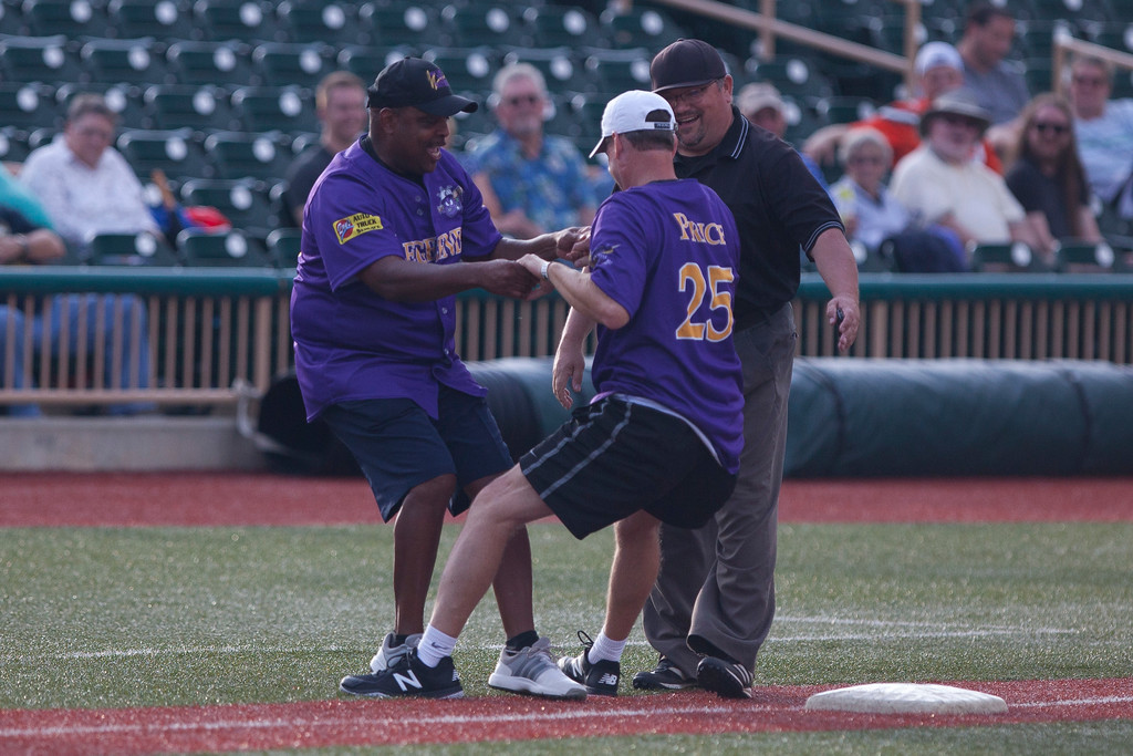 . Jen Forbus - The Morning Journal<br> After going down for a slide, Mark Price needs a little help getting back on his feet during the Cleveland Legends softball game on June 23 at Sprenger Stadium.