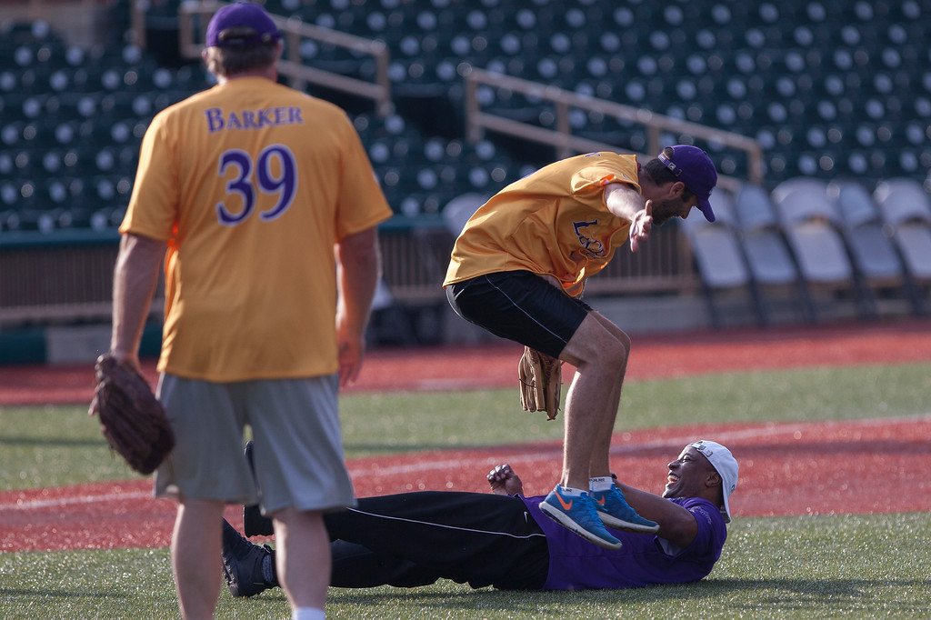 . Jen Forbus - The Morning Journal<br> Fellow ESPN radio hosts converge on third base as Je\'Rod Cherry tries to slide in under Dave Skoczen during the Cleveland Legends softball game on June 23 at Sprenger Stadium.