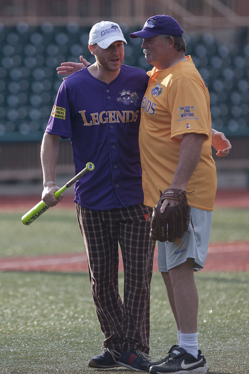 . Jen Forbus - The Morning Journal<br> Before his at bat, comedian Mike Polk charged the mound to get a picture with his idol, former Cleveland Indian Len Barker during the Cleveland Legends softball game on June 23 at Sprenger Stadium.