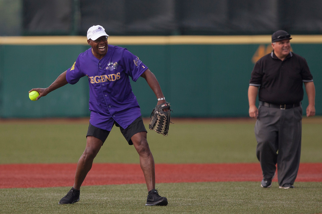 . Jen Forbus - The Morning Journal<br> Purple team short stop and former Cleveland Brown Kevin Mack smiles while making a play during the Cleveland Legends softball game on June 23 at Sprenger Stadium.