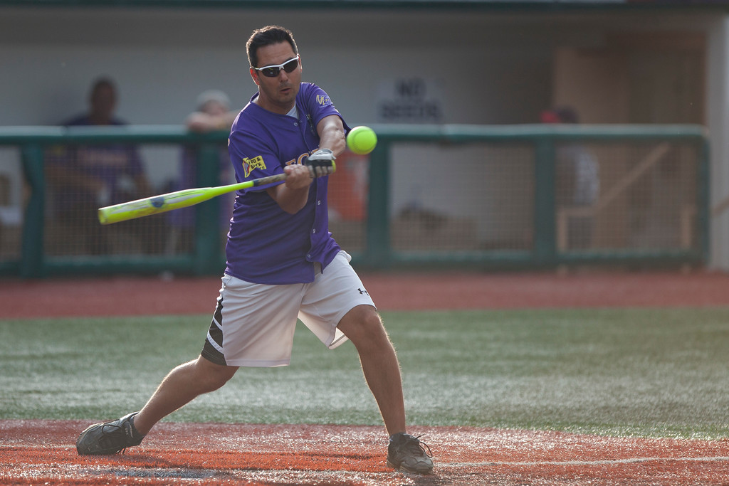. Jen Forbus - The Morning Journal<br> Channel 19\'s Jason Nicholas takes a swing at a pitch during the Cleveland Legends softball game on June 23 at Sprenger Stadium.