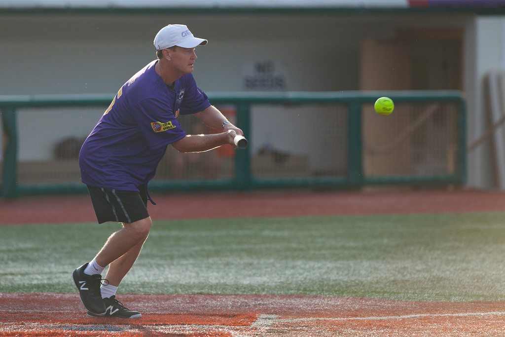 . Jen Forbus - The Morning Journal<br> Mark Price lays down a bunt for the Purple team during the Cleveland Legends softball game on June 23 at Sprenger Stadium.