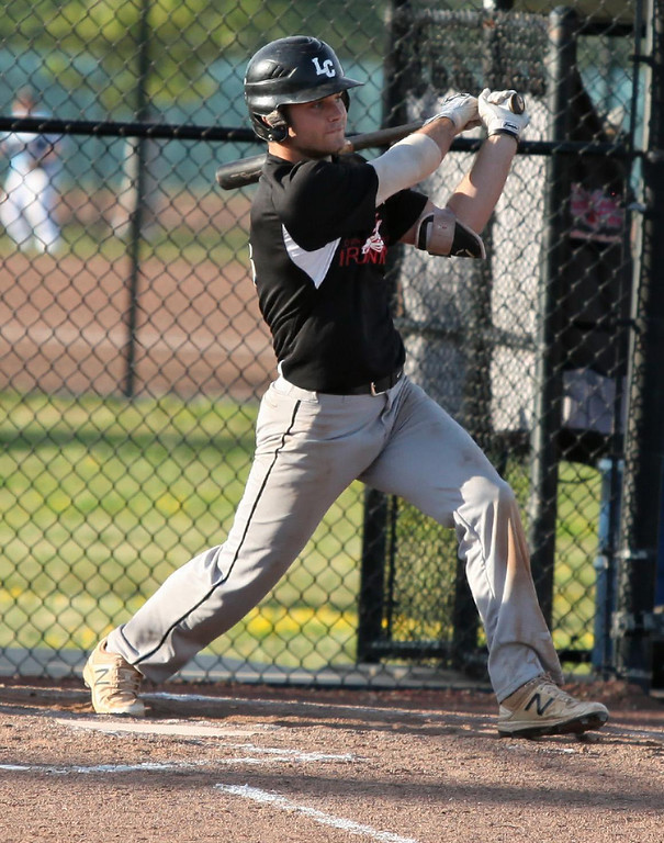 . Randy Meyers - The Morning Journal Cole Revels of the Ironmen lines a base hit against the Spartans on Monday.