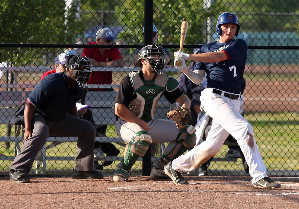 . Randy Meyers - The Morning Journal Alex Ludwick of the Spartans fouls off a pitch against the Ironmen on Monday.